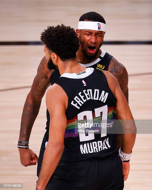 Torrey Craig of the Denver Nuggets and Jamal Murray of the Denver Nuggets react to a shot during the fourth quarter against the Los Angeles Lakers in...