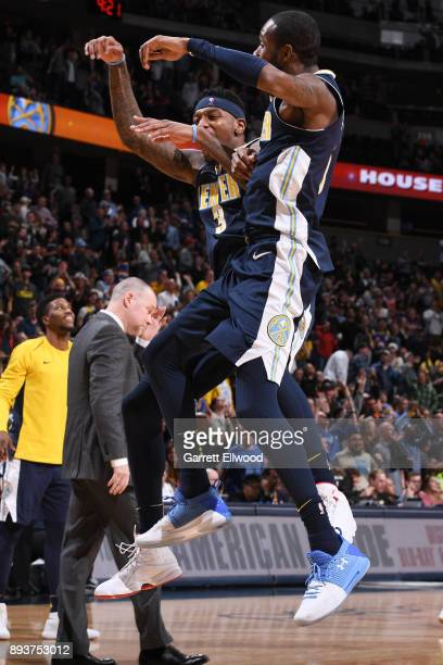 Torrey Craig of the Denver Nuggets and Will Barton of the Denver Nuggets celebrate on the court in overtime against the New Orleans Pelicans on...