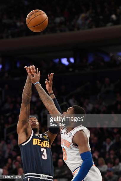 Torrey Craig of the Denver Nuggets attempts a basket against Kadeem Allen of the New York Knicks during the first half of the game at Madison Square...
