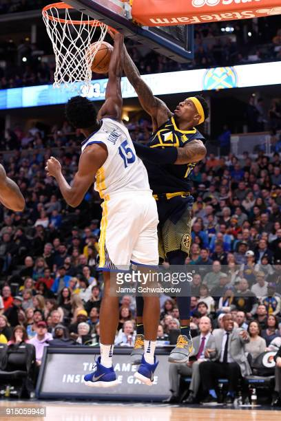 Torrey Craig of the Denver Nuggets drives past Damian Jones of the Golden State Warriors at Pepsi Center on February 3 2018 in Denver Colorado NOTE...