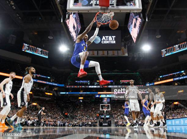 Torrey Craig of the Denver Nuggets dunks against the San Antonio Spurs during Game Four of the first round of the 2019 NBA Western Conference...