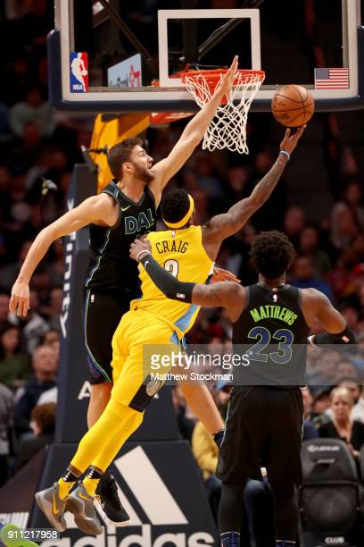 Torrey Craig of the Denver Nuggets goes to the basket against Maxi Kleber and Wesley Matthews of the Dallas Mavericks at the Pepsi Center on January...