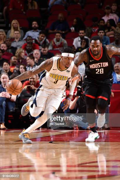 Torrey Craig of the Denver Nuggets handles the ball against Tarik Black of the Houston Rockets during the game between the two teams on February 9...