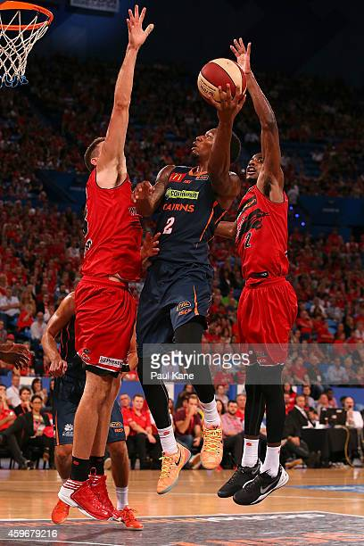 Torrey Craig of the Taipans puts up a shot against Tom Jervis and DeAndre Daniels of the Wildcats during the NBL round eight game between the Perth...