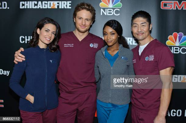 Torrey Devito Nick Gehlfuss Yaya DaCosta and Brian Tee attend the press junket for 'One Chicago' on October 30 2017 in Chicago Illinois