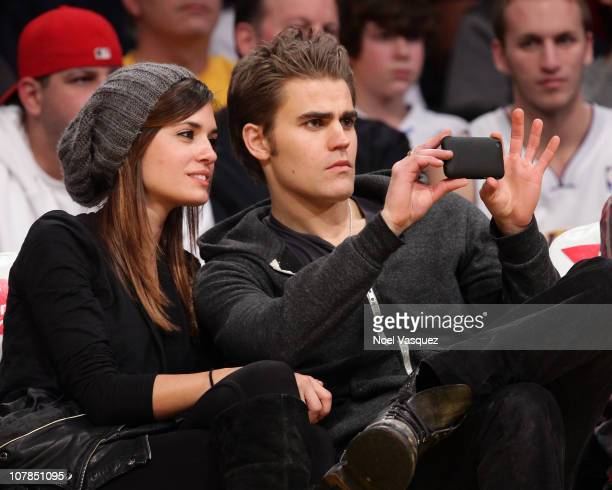 Torrey DeVitto and Paul Wesley attend a game between the Memphis Grizzlies and the Los Angeles Lakers at Staples Center on January 2 2011 in Los...