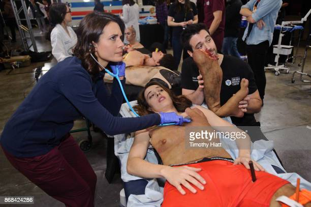 Torrey Devitto Marina Squerciati and Colin Donnell take part in a behindthescenes show and tell at the NBC 'One Chicago' press day on October 30 2017...