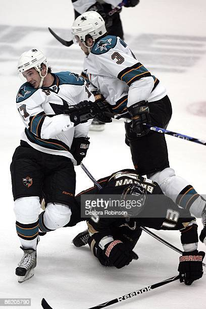 Torrey Mitchell and Douglas Murray of the San Jose Sharks collides with Mike Brown of the Anaheim Ducks during Game Four of the Western Conference...