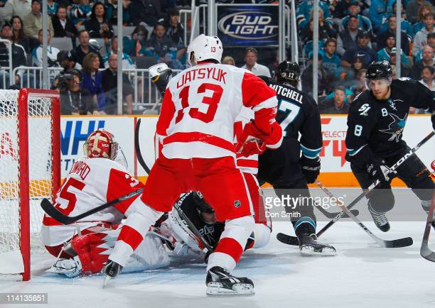 Torrey Mitchell and Joe Pavelski of the San Jose Sharks attack the net against Pavel Datsyuk and Jimmy Howard of the Detroit Red Wings in Game Seven...