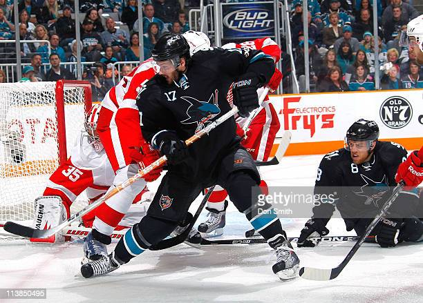 Torrey Mitchell and Joe Pavelski of the San Jose Sharks try to score against Brian Rafalski, Niklas Kronwall, and Jimmy Howard of the Detroit Red...