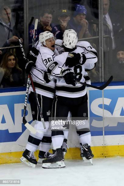 Torrey Mitchell Jussi Jokinen and Drew Doughty of the Los Angeles Kings celebrate after scoring the game tying goal in the third period against...