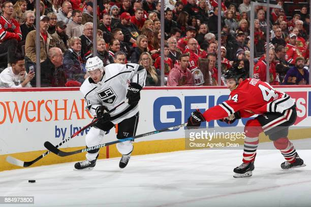 Torrey Mitchell of the Los Angeles Kings and Jan Rutta of the Chicago Blackhawks chase the puck in the first period at the United Center on December...