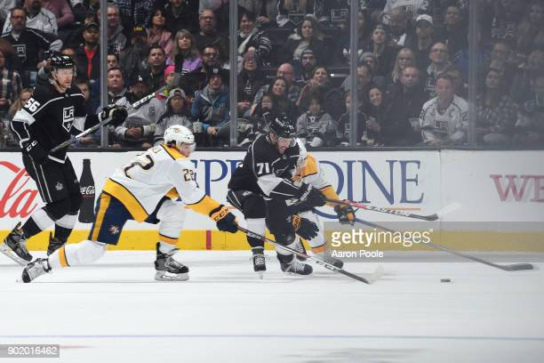 Torrey Mitchell of the Los Angeles Kings battles for the puck against Kevin Fiala of the Nashville Predators at STAPLES Center on January 6 2018 in...