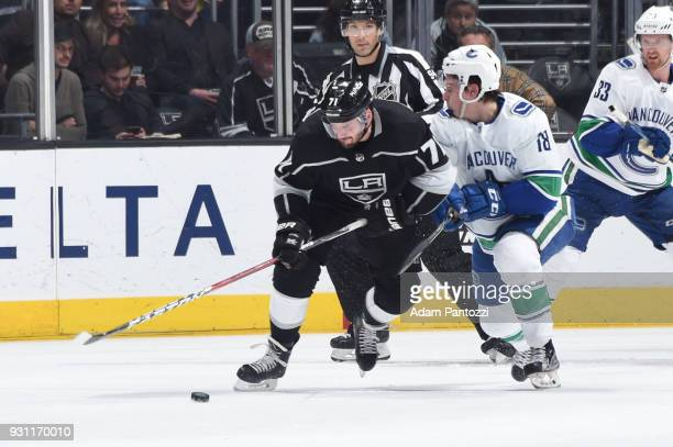Torrey Mitchell of the Los Angeles Kings battles for the puck against Jake Virtanen of the Vancouver Canucks at STAPLES Center on March 12 2018 in...