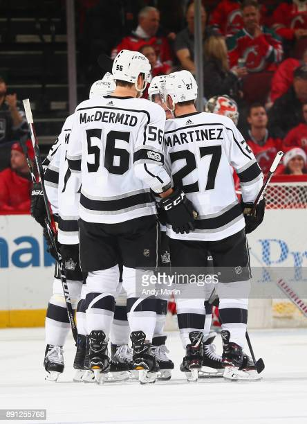 Torrey Mitchell of the Los Angeles Kings is congratulated after scoring a goal against the New Jersey Devils during the game at Prudential Center on...