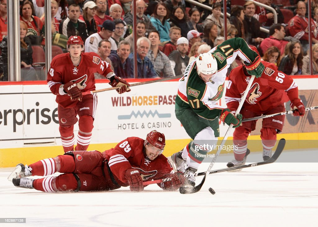 Torrey Mitchell #17 of the Minnesota Wild steals the puck away from Mikkel Boedker #89 of the Phoenix Coyotes during the third period at Jobing.com Arena on February 28, 2013 in Glendale, Arizona.
