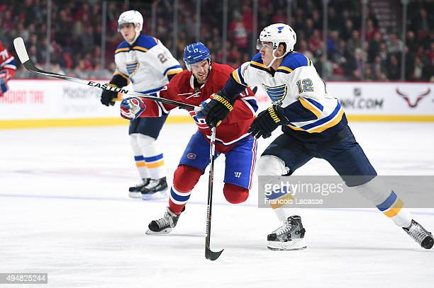 Torrey Mitchell of the Montreal Canadiens and Jori Lehtera of the St-Louis Blues skate for position in the NHL game at the Bell Centre on October 20,...