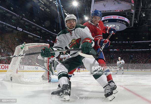 Torrey Mitchell of the Montreal Canadiens and Matt Dumba of the Minnesota Wild battle for position in the NHL game at the Bell Centre on December 22...