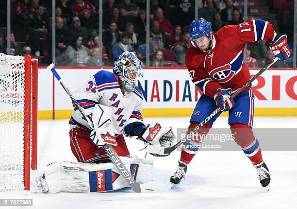 Torrey Mitchell of the Montreal Canadiens attempts to deflect the puck against Antti Raanta of the New York Rangers in the NHL game at the Bell...