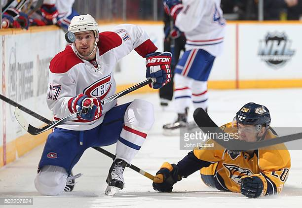 Torrey Mitchell of the Montreal Canadiens eyes the puck against Miikka Salomaki of the Nashville Predators during an NHL game at Bridgestone Arena on...