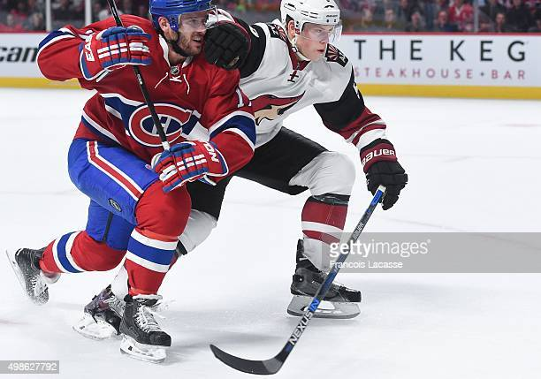 Torrey Mitchell of the Montreal Canadiens fights for the puck against Connor Murphy of the Arizona Coyotes in the NHL game at the Bell Centre on...