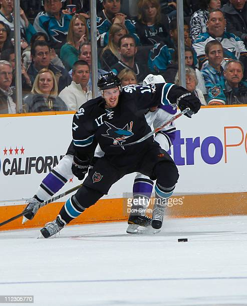 Torrey Mitchell of the San Jose Sharks fights for the pucks against the Los Angeles Kings in Game One of the Western Conference Quarterfinals during...