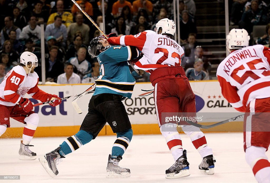 Torrey Mitchell #17 of the San Jose Sharks gets hit by Brad Stuart #23 of the Detroit Red Wings in Game One of the Western Conference Semifinals during the 2010 NHL Stanley Cup Playoffs at HP Pavilion on April 29, 2010 in San Jose, California.