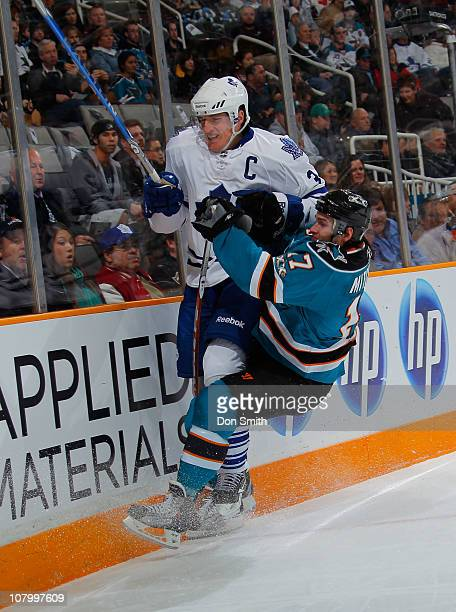 Torrey Mitchell of the San Jose Sharks hits Dion Phaneuf of the Toronto Maple Leafs during an NHL game on January 11, 2011 at HP Pavilion at San Jose...