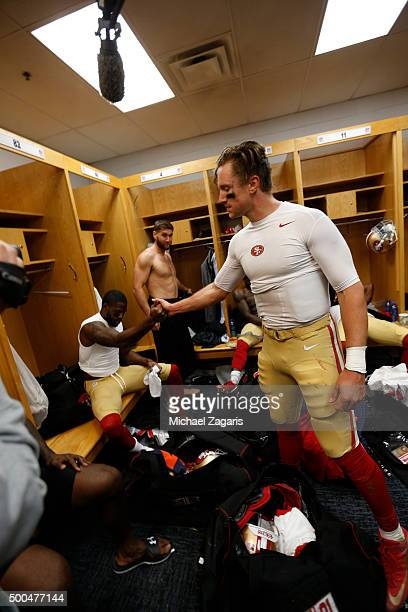 Torrey Smith and Blaine Gabbert of the San Francisco 49ers celebrate in the locker room following the game against the Chicago Bears at Soldier Field...