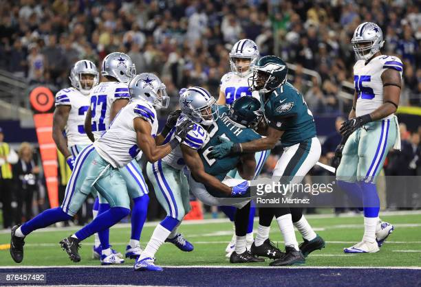 Torrey Smith of the Philadelphia Eagles battles for the twopoint conversion against Anthony Brown of the Dallas Cowboys in the third quarter at ATT...