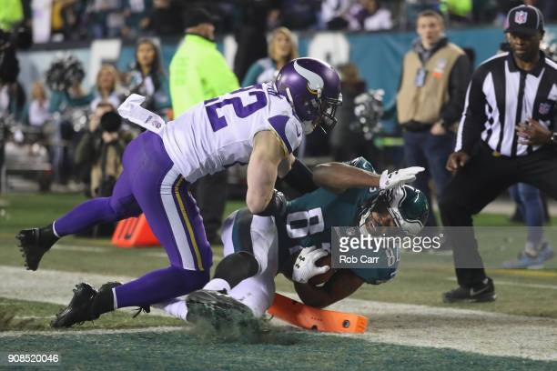 Torrey Smith of the Philadelphia Eagles scores a third quarter touchdown past Harrison Smith of the Minnesota Vikings in the NFC Championship game at...
