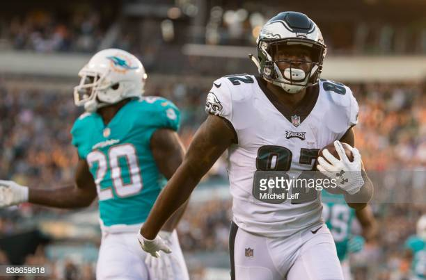Torrey Smith of the Philadelphia Eagles scores a touchdown against Reshad Jones of the Miami Dolphins in the first quarter of the preseason game at...