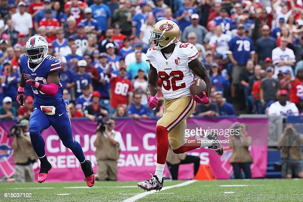 Torrey Smith of the San Francisco 49ers breaks free of Aaron Williams of the Buffalo Bills for a touchdown during the first half at New Era Field on...