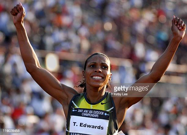 Torri Edwards celebrates after winning the women's 100 meters in 11.02 in the USA Track & Field Championships at Carroll Stadium in Indianapolis,...