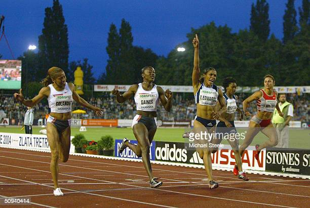 Torri Edwards of United States celebrates victory in the women's 100m at the IAAF Golden Spike meet in Ostrava Czech Republic
