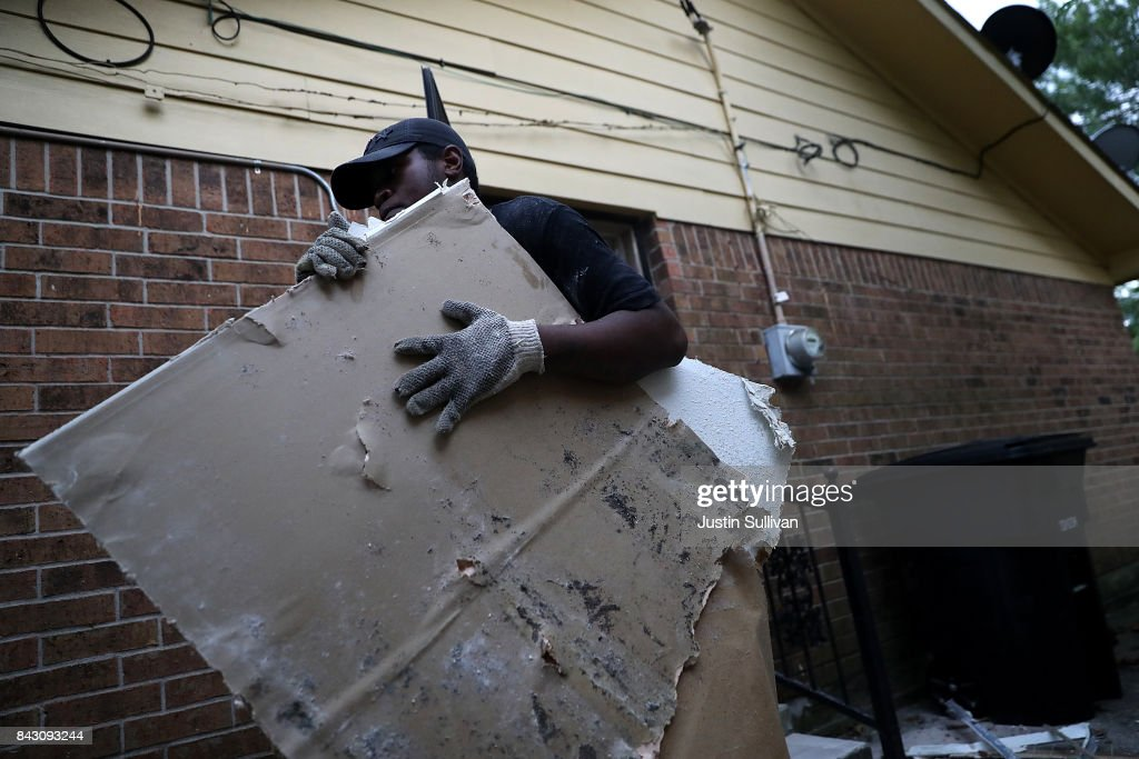 Torrian Green of Top to Bottom Home Renovations removes moldy drywall from a flood damaged home that he is cleaning out on September 5, 2017 in Houston, Texas. Over a week after Hurricane Harvey hit Southern Texas, residents are beginning the long process of recovering from the storm.