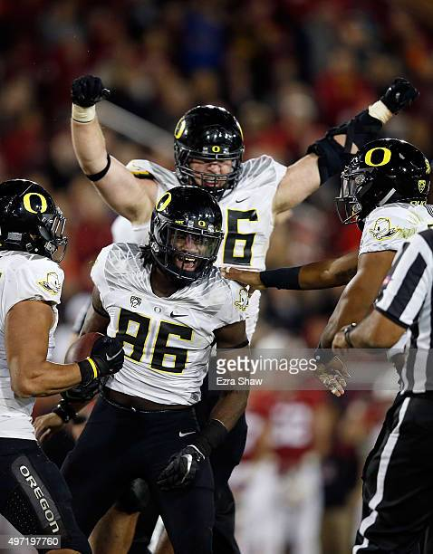 Torrodney Prevot of the Oregon Ducks celebrates with Alex Balducci and Rodney Hardrick of the Oregon Ducks after he recovered a fumble by the...