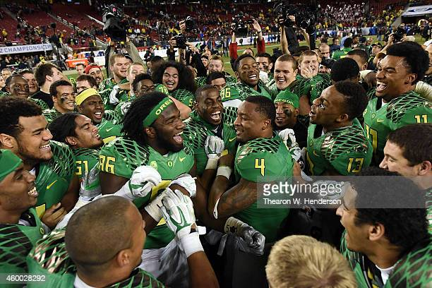 Torrodney Prevot of the Oregon Ducks center and Erick Dargan of the Oregon Ducks center right celebrate their PAC12 victory against the Arizona...
