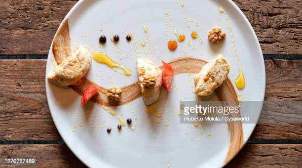 torroncino semifreddo dessert with strawberries and walnuts, italy - nougat stock pictures, royalty-free photos & images
