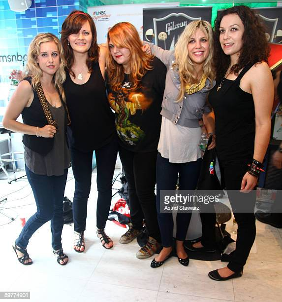 Torry Castellano Brett Anderson Maya Ford Allison Robertson and Amy Cesari of The Donnas pay tribute to Les Paul at the NBC Experience Store as part...