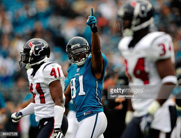 Torry Holt of the Jacksonville Jaguars celebrates a reception during against the Houston Texans at Jacksonville Municipal Stadium on December 6 2009...