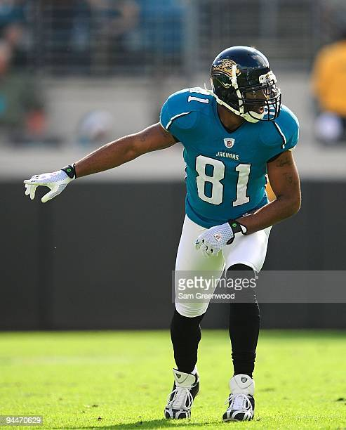 Torry Holt of the Jacksonville Jaguars prepares to run a route during the game against the Miami Dolphins at Jacksonville Municipal Stadium on...