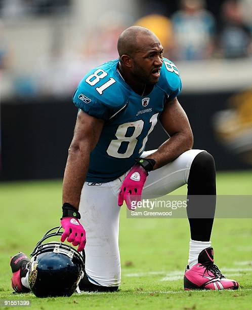 Torry Holt of the Jacksonville Jaguars rests during the game against the Tennessee Titans at Jacksonville Municipal Stadium on October 4 2009 in...