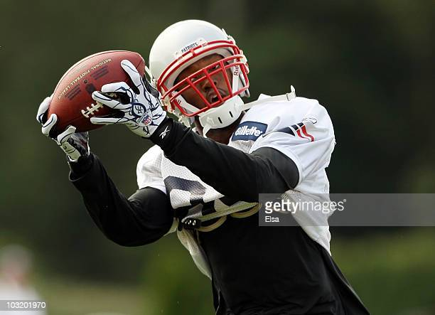 Torry Holt of the New England Patriots catches a pass during training camp on August 2 2010 at Gillette Stadium in Foxboro Massachusetts