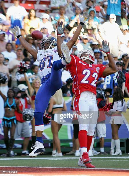 Torry Holt of the NFC team is unable to catch the ball as Nate Clements of the AFC team defends during the NFL Pro Bowl on February 13 2005 at Aloha...