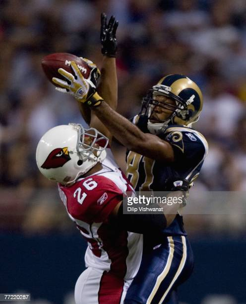 Torry Holt of the St Louis Rams attempts to catch a pass against Roderick Hood of the Arizona Cardinals at the Edward Jones Dome October 7 2007 in St...