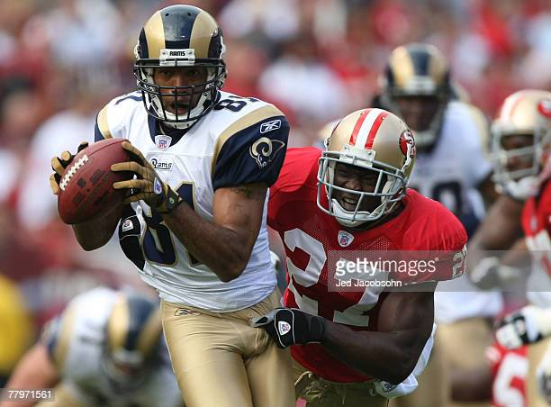 Torry Holt of the St Louis Rams catches a pass past Walt Harris of the San Francisco 49ers at Monster Park November 18 2007 in San Francisco...