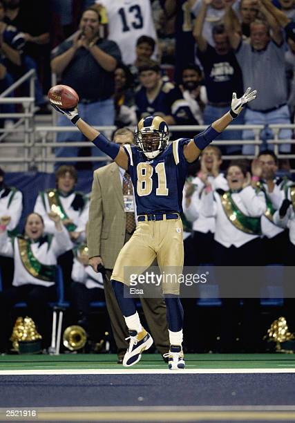 Torry Holt of the St Louis Rams celebrates his touchdown against the San Francisco 49ers on September 14 2003 at the Edward Jones Dome in St Louis...