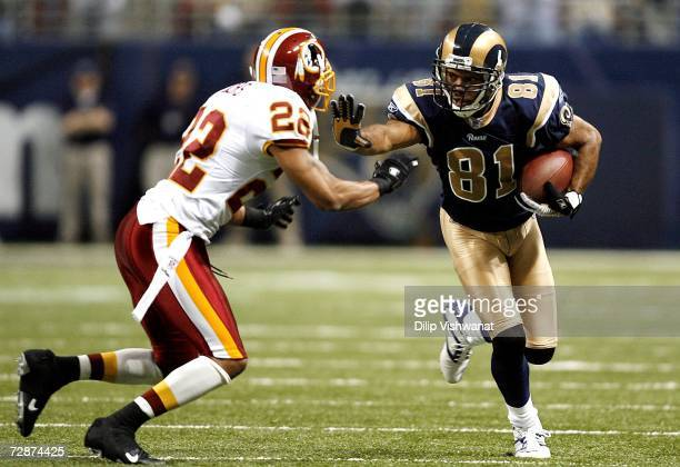 Torry Holt of the St Louis Rams looks to avoid Carlos Rogers of the Washington Redskins at the Edward Jones Dome on December 24 2006 in St Louis...