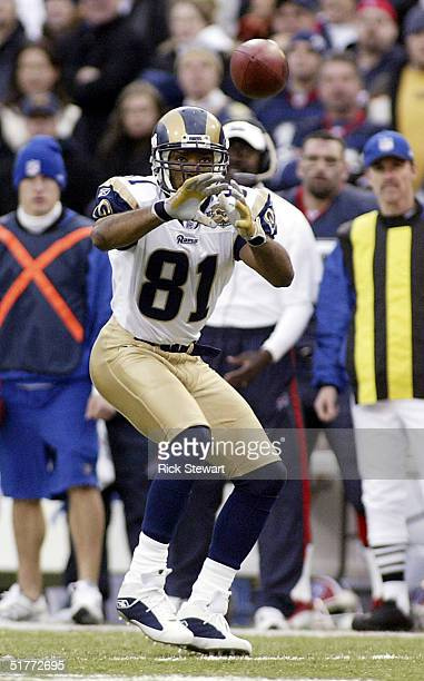 Torry Holt of the St Louis Rams makes a catch against the Buffalo Bills on November 21, 2004 at Ralph Wilson Stadium in Orchard Park, New York.